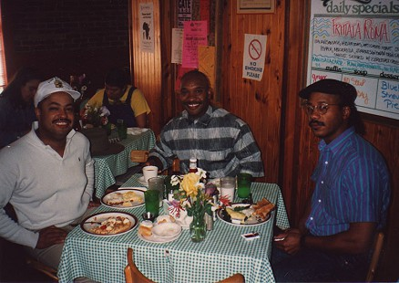 E. Lynn Harris with his friends at a restaurant © Pryor Center for Arkansas Oral and Visual History, University of Arkansas